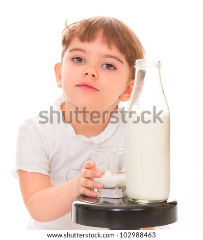 portrait of a young girl with a bottle of milk - stock photo