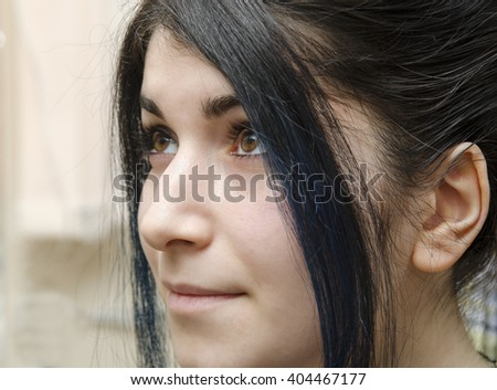 portrait of a young girl with black hair and brown eyes and aquiline nose - stock photo