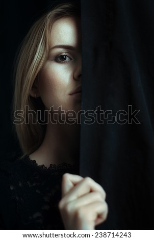 Portrait of a young girl with clean skin on a black background close-up - stock photo