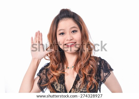 portrait of a young girl with hand gesture - stock photo