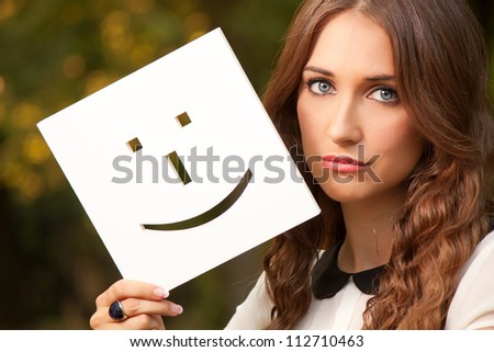 Portrait of a young girl with smiley - stock photo