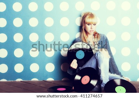Portrait of a young girl with vinyl records in the hands - stock photo