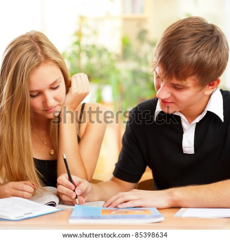 Portrait of a young group of students paying attention and doing exercises in class. - stock photo
