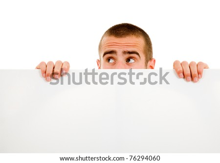 Portrait of a young guy holding blank billboard - stock photo