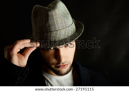Portrait of a young guy with a cool hat - stock photo