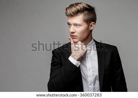 Portrait of a young handsome business man. - stock photo