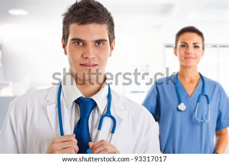 Portrait of a young handsome doctor - stock photo