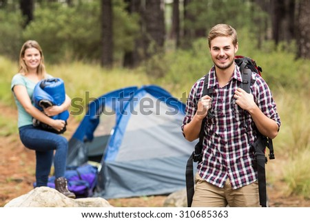 Portrait of a young handsome hiker in the nature - stock photo