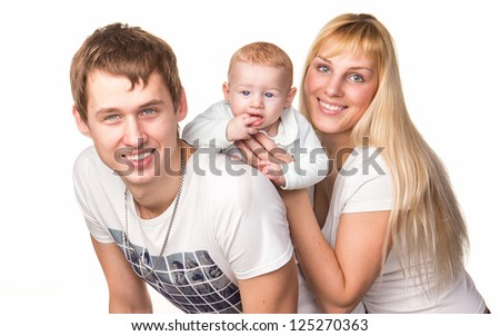 Portrait of a young happy family: mother, father and baby smiling isolated on white - stock photo