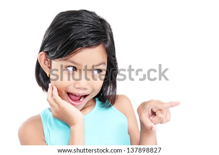 Portrait of a young happy girl pointing to somebody. - stock photo