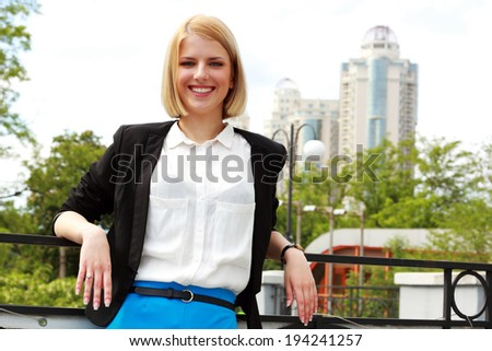 Portrait of a young happy woman outdoors - stock photo