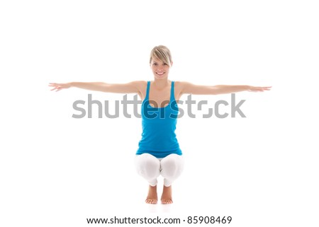 Portrait of a young healthy woman doing fitness exercises, isolated over white background, series photos - stock photo
