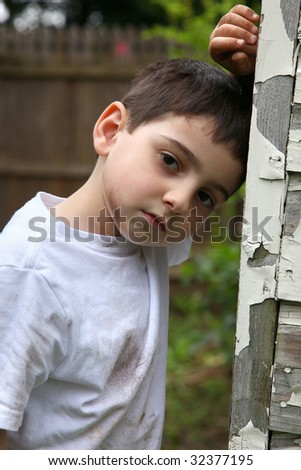 Portrait of a young impoverished or runaway French-American boy. - stock photo