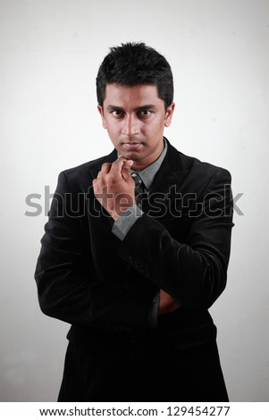 Portrait of a young Indian business executive - stock photo
