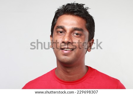 Portrait of a young Indian with smiling expression - stock photo