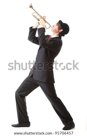 Portrait of a young jazz man playing his Trumpet white background - stock photo