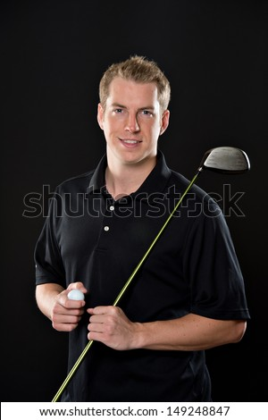 Portrait of a young male model in golf attire, holding a driver.  - stock photo