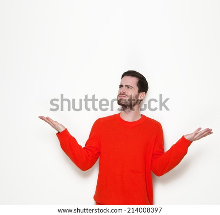 Portrait of a young man asking questions with hands raised - stock photo