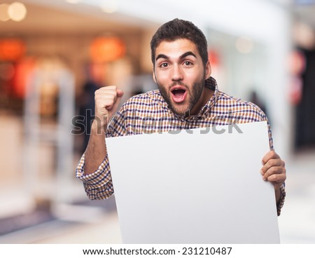 portrait of a young man behind a banner - stock photo
