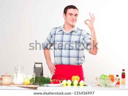 portrait of a young man, hold egg, ok - stock photo
