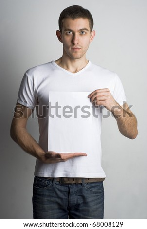 Portrait of a young man holding a blank board for text - stock photo