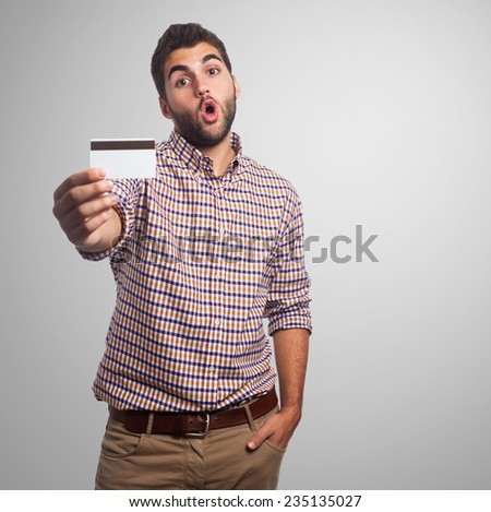 portrait of a young man holding a credit card - stock photo