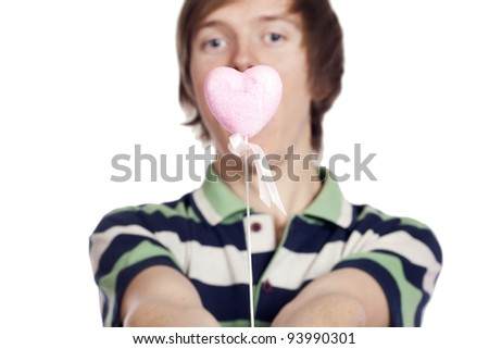 Portrait of a young man holding heart shape toy - stock photo