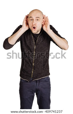 Portrait of a young man holds his hand near his ear and listening. human emotion expression and lifestyle concept. image on a white studio background.  - stock photo