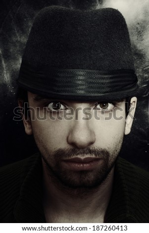 Portrait of a young man in a hat closeup - stock photo