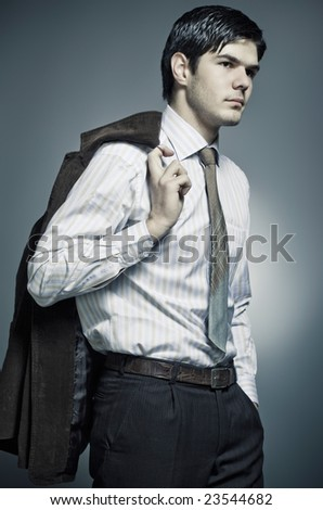 portrait of a young man in a suit, studio shot - stock photo