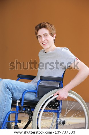 Portrait of a young man in a wheelchair - stock photo