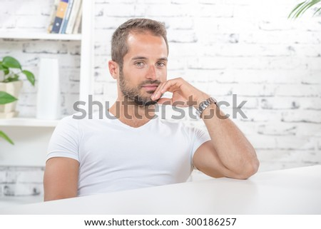 portrait of a young man in his office - stock photo