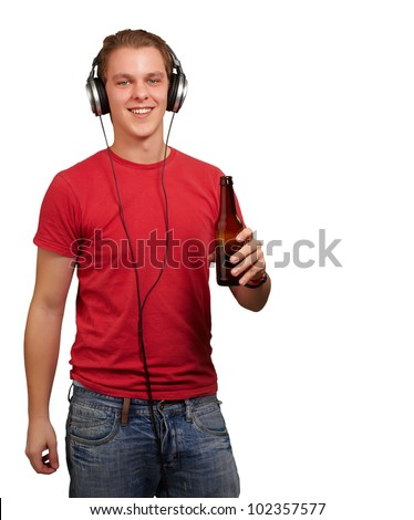 portrait of a young man listening to music and holding a beer over a white background - stock photo