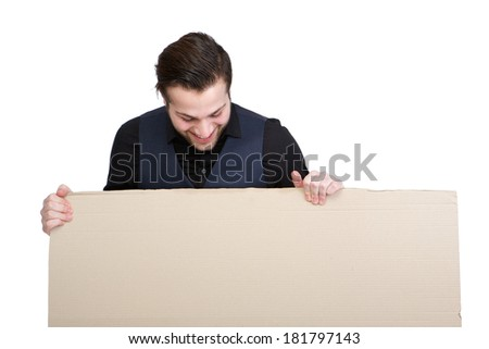 Portrait of a young man looking down on blank poster sign - stock photo