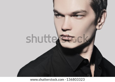 portrait of a young man on a gray background - stock photo