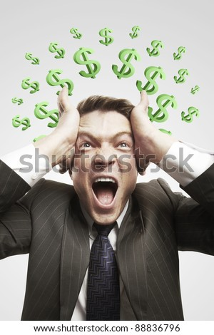 Portrait of a young man shouting loud with green question marks above his head. Conceptual image of a open minded man. On a gray background - stock photo