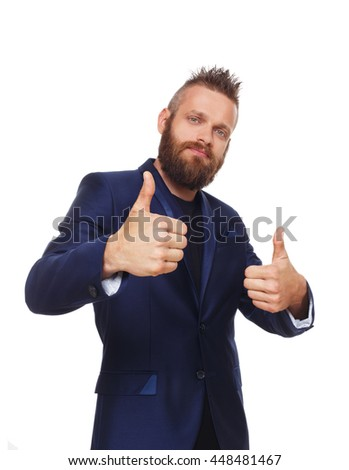Portrait of a young man showing thumbs up isolated. Stylish hipster with beard shows approval, acceptance and encouragement sign. Well done symbol. Male portrait with positive emotion. - stock photo