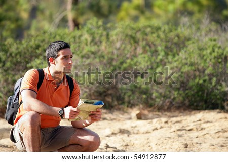 Portrait of a young man sitting with a plan in his hands - stock photo