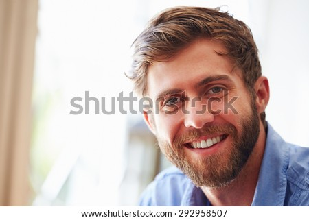 Portrait of�¿a young man smiling - stock photo
