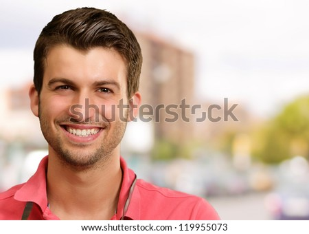 Portrait Of A Young Man Smiling, Outdoor - stock photo