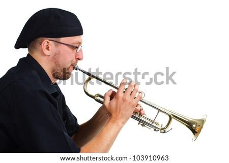 Portrait of a young man wearing black shirt and cap, playing the trumpet - isolated on white - stock photo