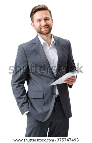 Portrait of a young man with a digital tablet isolated on white background - stock photo