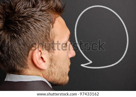 portrait of a young man with a empty speech bubble over his head - stock photo