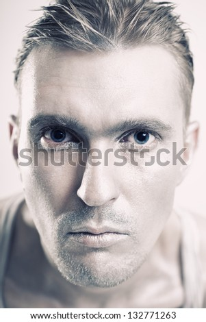 Portrait of a young man with a metallic makeup on her face close-up - stock photo