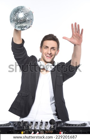 Portrait of a young man with a mirror ball and dj mixer on a white background. - stock photo