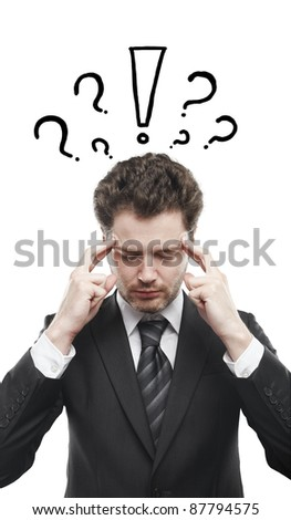 Portrait of a young man with exclamation mark and question marks above his head. Conceptual image of a open minded man. - stock photo