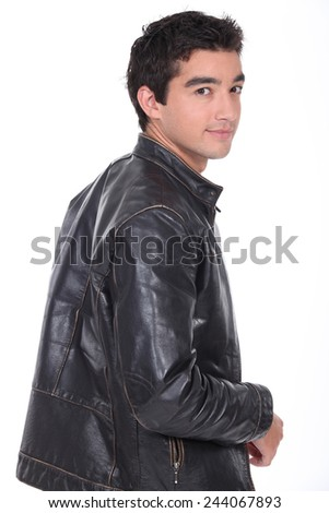 portrait of a young man with leather jacket - stock photo