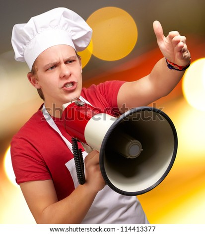 Portrait Of A Young Man With Megaphone, Background - stock photo