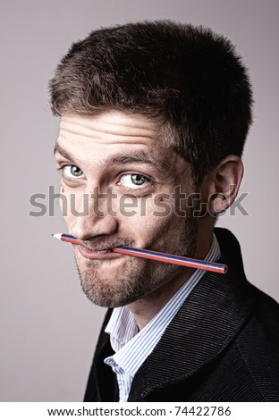 portrait of a young man with pencil - stock photo
