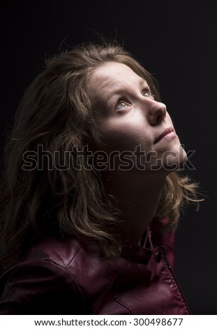 Portrait of a young men looking up, in sci fi atmosphere. - stock photo